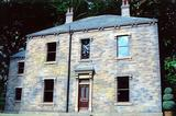 Natural stone elevations, cut stone heads and cill's with slate roof & traditional sash windows.