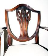 Carver chair with shaped arms.