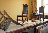 Mahogany, upholstered chairs being prepared for restoration.