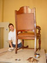 Rear of mahogany carver chair, finishing touches being applied