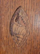 Conch shell inlay, prior to restoration on door.