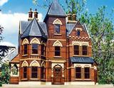 Red Brick, interspersed with ornamental patterned brickwork, ditto stone heads & cills, hardwood windows and door with multi faceted blue slate roof.